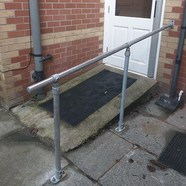 Floor to wall mounted handrails